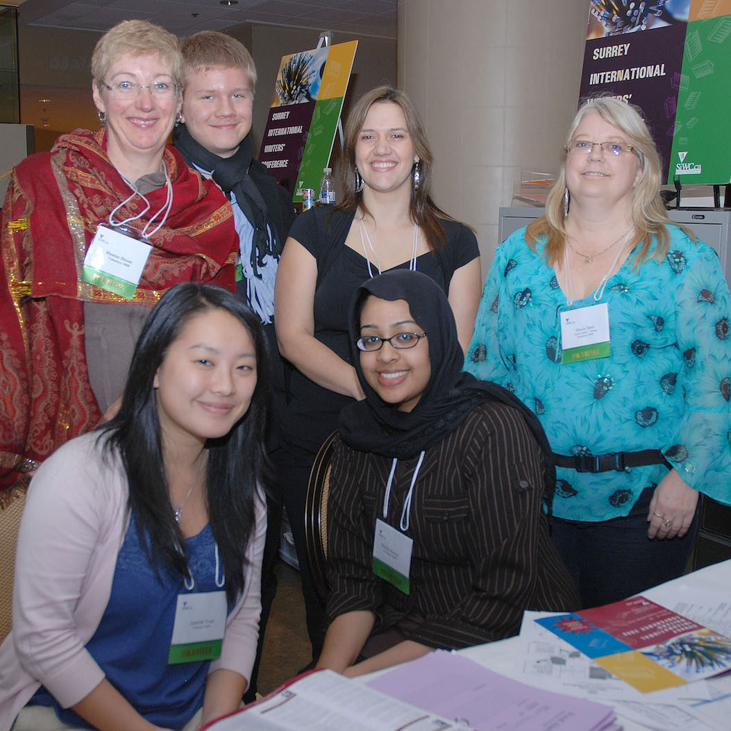 Resized - SiWC volunteers at desk
